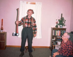 Dad as a lumberjack, with Grandpa Powers watching.
